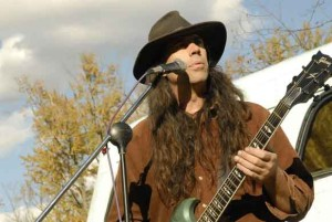 Crow Weaver, Lead vocals, guitar, flute, sax, banjo, Native Earthling Band. Copyright Lorna Reichel. All rights reserved.